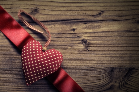satin ribbon: Dotted Fabric heart with satin ribbon wood background