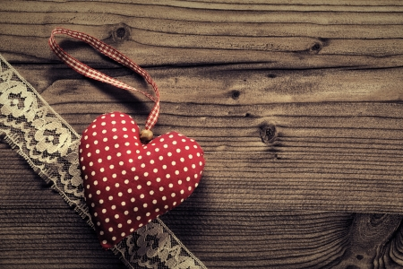 plano: Dotted Fabric heart with lace wood background  Stock Photo
