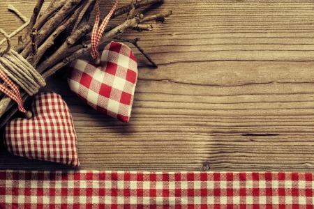 Textile hearts on twig - Harmony background Standard-Bild