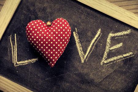 Written in chalk on a blackboard  Love  photo