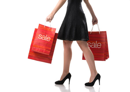 female legs with sale bags photo