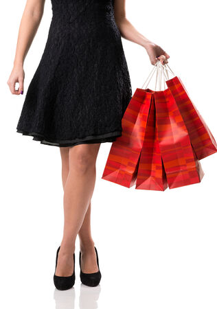 Pretty woman and  sale, detail photo, female legs with sale bags photo