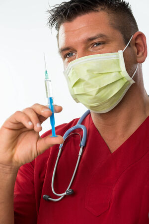 Handsome young doctor with mouth mask, stethoscope  photo