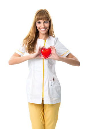 Beautiful   nurse ,holding  red heart photo
