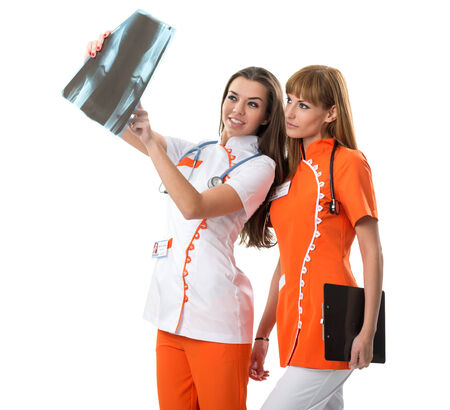 Two nurse  watching X Ray image photo