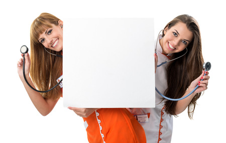 Two nurses  Look behind blank board with stethoscope photo