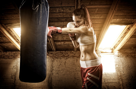 Young woman boxing workout on the attic  photo