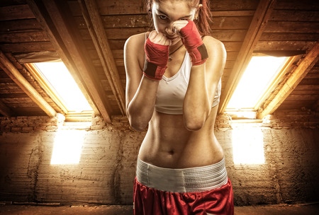 Young women boxing, exercise in the attic photo