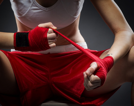 bandage: Boxing woman binds the bandage on his hand, before training, detail photo