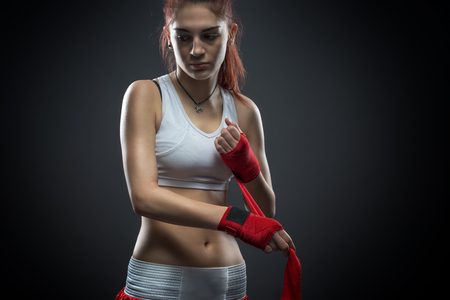 Boxing woman binds the bandage on his hand, before training, detail photo photo