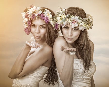 Two beautiful spring fairy , brides sending a kiss to you photo
