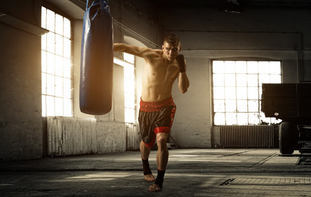 boxing boy: Young man boxing workout in an old building Stock Photo