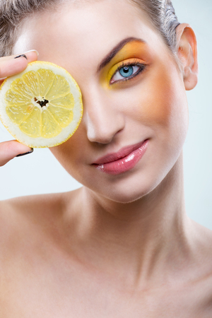 Beautiful woman with lemon and yellow makeup  photo