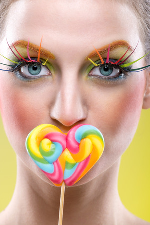 Colorful twisted lollipop and colorful fashion makeup photo
