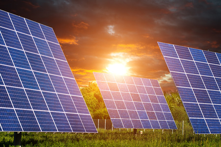 power of money: Solar Panels with beautiful clouds and sunshine