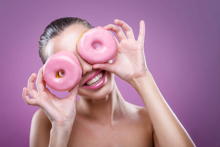 Beautiful woman with donuts, his two eyes are pink  donut photo