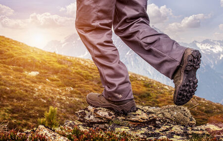 walking boots: Hiker  standing on top of a mountain and enjoying sunrise