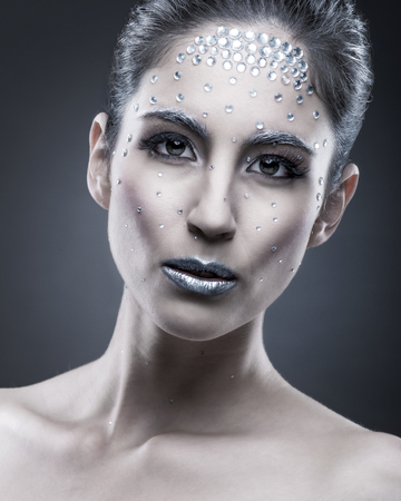 Portrait of sexual beautiful girl with crystal on face photo