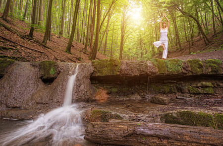 pureness: Relaxation, Woman practices yoga at the waterfall