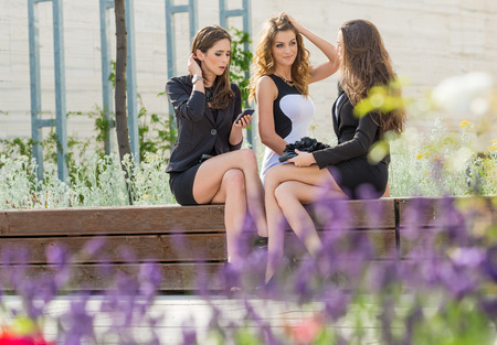 Successful businesswomen in the city on a bench photo