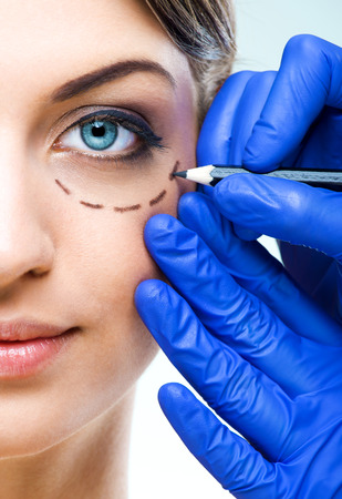 DERMATOLOGY: Plastic surgery - Beautiful Woman half face, with marked Stock Photo