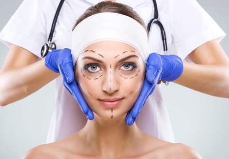 Plastic surgery - Beautiful woman face, with surgical markings  photo