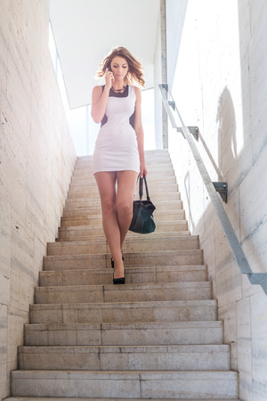 Pretty businesswoman walk on the stairs Zdjęcie Seryjne