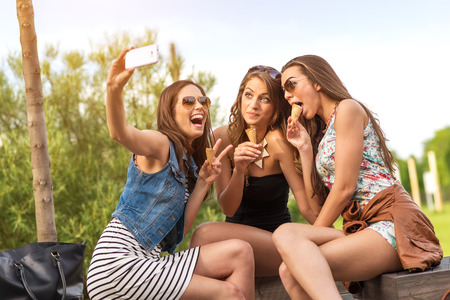3 beautiful girlfriend eating ice cream while Selfie photo photo