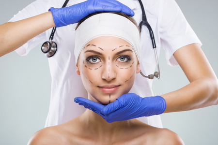procedure: Beautiful woman with plastic surgery, depiction, plastic surgeon hands Stock Photo