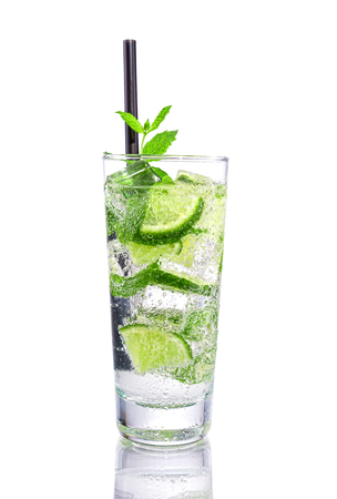 Mojito with lime and mint on isolated white photo