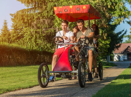 trishaw: four young people in a four-wheeled bicycle