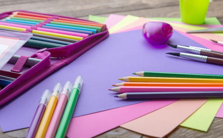 subtitles: Many school stationery in a heap, cozy colors Stock Photo