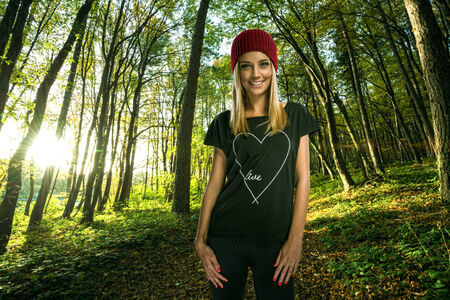 Beautiful blond woman in autumn fashion clothes , in the sunny autumn forest photo