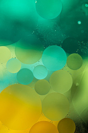 Green, Yellow Gradient Oil drops in the water -abstract background