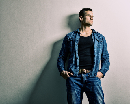 man isolated: Handsome man - full jeans, thinking relies on the Wall Stock Photo