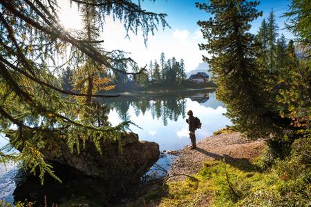 The hiker man at  the beautiful  Lago Di Federa See early  morning photo