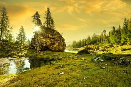 Italy, Dolomites - sunrise behind the rocks photo