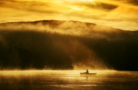 mist: Early morning sunrise, boating on the lake in the sunlight