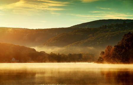 Beautiful autumn landscape, the lake in the morning fog photo