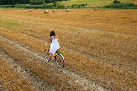 plan view: Beautiful woman with old bike in the wheat field Stock Photo