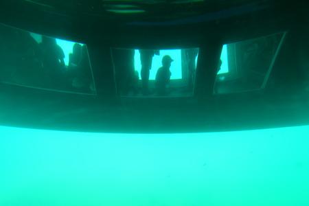 small boat: Glass bottomed catamaran below the water