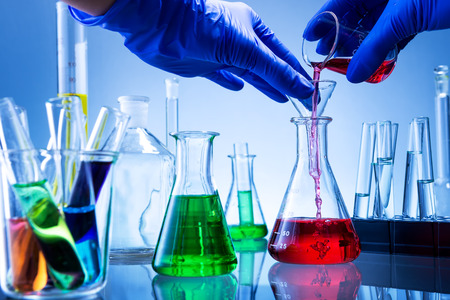 liquids: Laboratory equipment, lots of glass filled with colorful liquids, hand poured