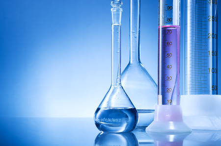 and of blue: Laboratory equipment, bottles, flasks with pink,light red  liquid