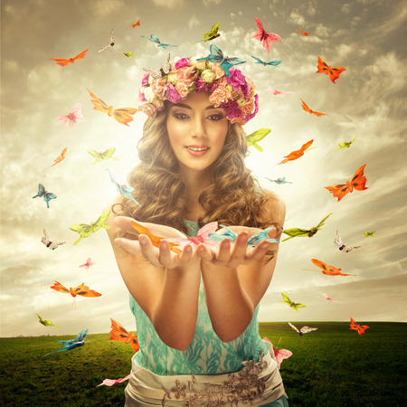 butterfly wings: Beautiful woman surrounds many butterfly Stock Photo