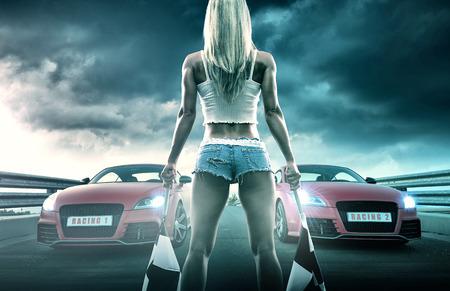 Sexy blonde woman starts racing Stockfoto