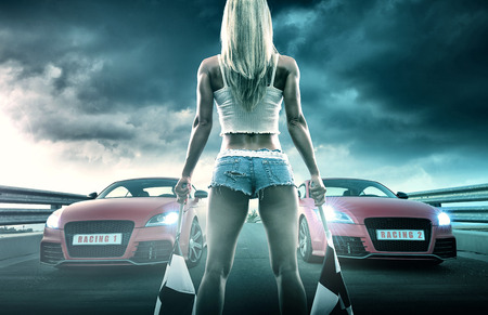 Sexy blonde woman starts racing Banque d'images