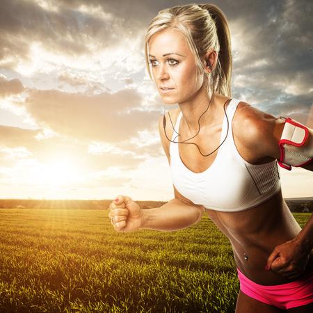 humanism: Woman fitness workout - running wheat field