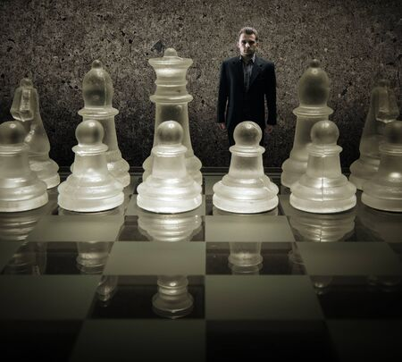 Glass chess board - We are puppets, Businessman of the king on the chessboard photo