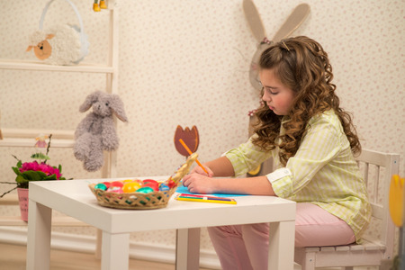 Little girl preparing for Easter - painting, drawing colored in the Room photo