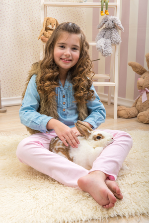 loves: Easter - Little girl loves live rabbit